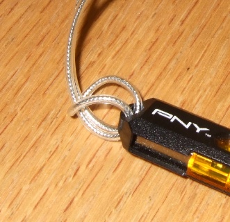 Fasten the strap to the USB flash drive